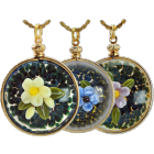 two glass round pendants with art glass forget me not flowers