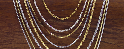 Jewelry chain styles on driftwood