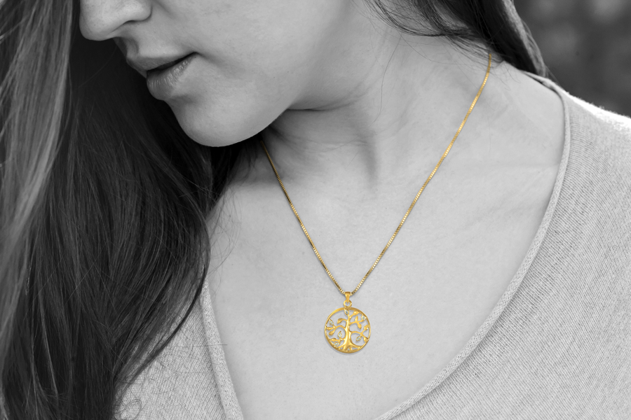 gold tree of life cremation pendant worn on young attractive woman